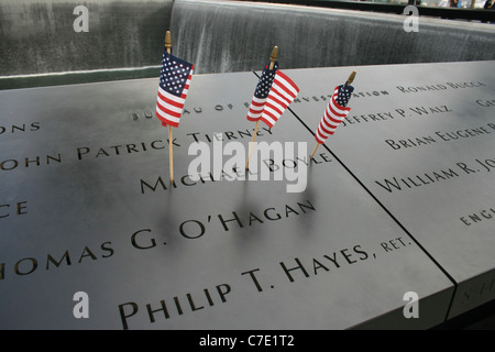 Flags left at the National September 11th Memorial at Ground Zero. - Stock Photo