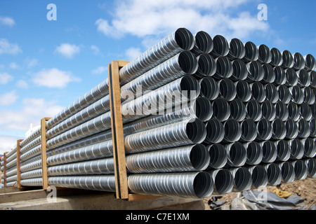 Galvanized steel pipes stacked at construction site - Stock Photo