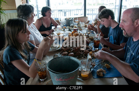 A family eating crabs at Bo Brooks Restaurant in Baltimore Maryland USA - Stock Photo