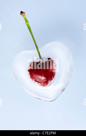 Frozen Heart Shaped Cherry on White Background - Stock Photo