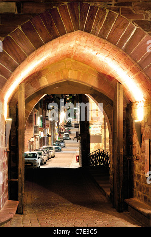 France, St. James Way: Medieval town gate Notre Dames in St. Jean-Pied-de-Port by night - Stock Photo
