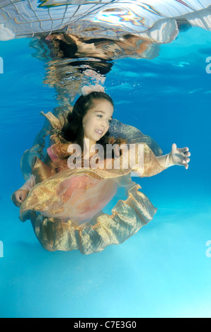 Underwater ART Fashion in pool - Stock Photo