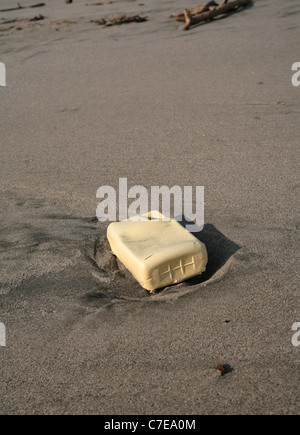 Low tide in an empty beach.  Plastic contamination. - Stock Photo