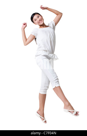 Young Woman Jumping in the Air - Stock Photo