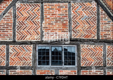 Old Oak timber framed house with Herringbone brickwork pattern. Whitchurch, Buckinghamshire, England - Stock Photo