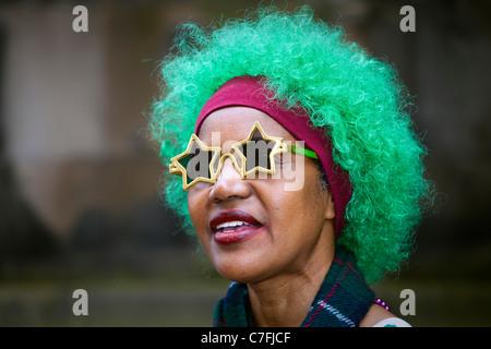 Woman performing in street theatre at the Edinburgh Fringe Festival, Scotland, UK - Stock Photo