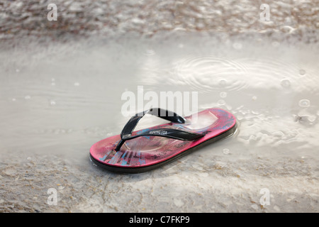 531e77496913c8 ... wet flip flop in water puddle during song kran buddhist new year  festival in silom road