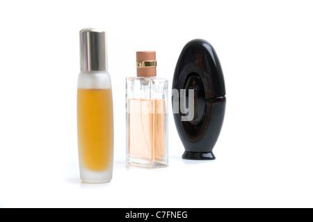 Three bottles of womens perfume on white background. - Stock Photo