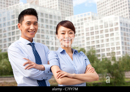 Colleagues Standing Confidently Together - Stock Photo