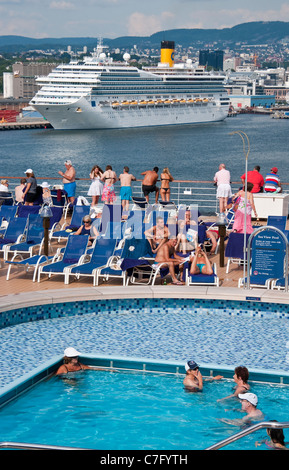 Costa Magica cruise ship in port of Oslo, Norway, as seen from rear pool deck of the Holland America Line's Eurodam. - Stock Photo