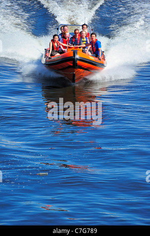 Speedboat on the Clyde (Note bottle floating in water just ahead of the boat). Space for text on water - Stock Photo