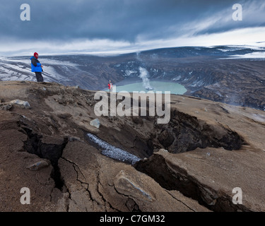 Scientist viewing steaming crater after Grimsvotn eruption, Iceland - Stock Photo