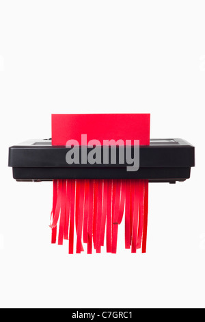 A blank document in a paper shredder - Stock Photo