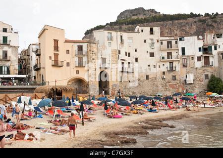 Cefalu beach, and medieval fishermen's houses, Cefalu, Sicily, Italy - Stock Photo