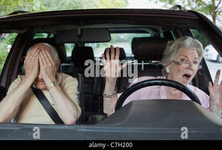 Senior woman having trouble learning to drive - Stock Photo