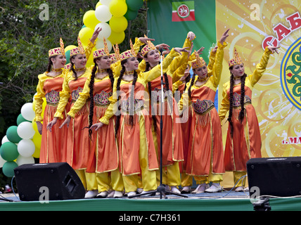 MAGNITOGORSK, RUSSIA - JUNE 18, 2011: Girls dancing in traditional dressing at the Sabantuy celebration - Stock Photo