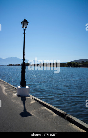 A lamppost on the causeway linking the holiday resort of Elounda to the Spinalonga peninsular - Stock Photo