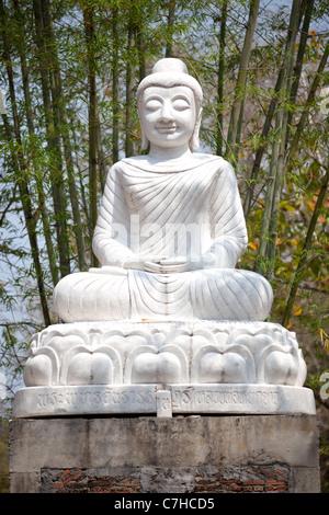 white buddha statue in thailand - Stock Photo
