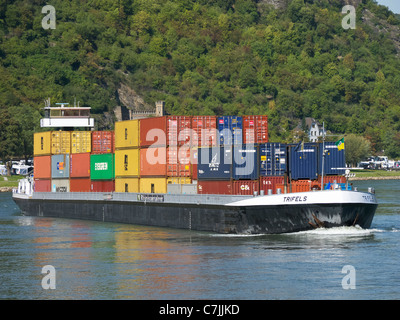 Large barge carrying container freight sailing up the River Rhine in Germany - Stock Photo