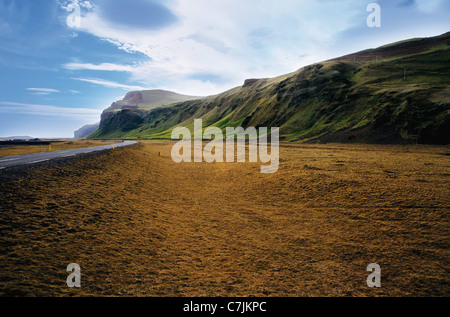 Paved road in dry rural landscape - Stock Photo