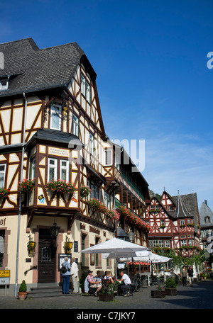 Old half timbered buildings in Bacharach in Rhineland beside River Rhine Germany - Stock Photo