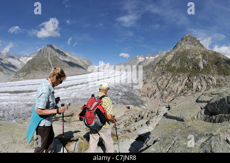 Switzerland, Valais, Western Europe, Aletsch Glacier (UNESCO world heritage site). Hikers on the panorama trail. - Stock Photo