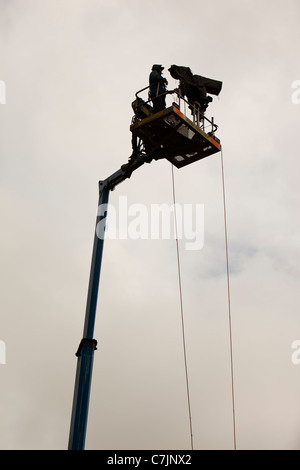 A man filming on a cherry picker at the World Sheep Dog Trials at Lowther, Penrith, cumbria, UK. - Stock Photo
