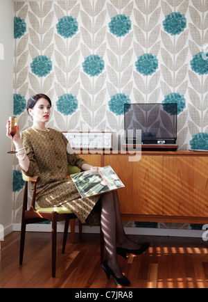 Woman in vintage dress with record - Stock Photo