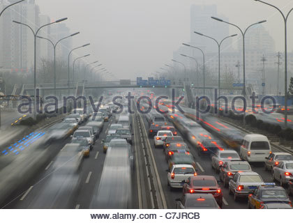Time lapse view of traffic on freeway - Stock Photo