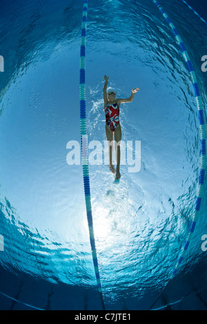 Olympic Swimming Pool Underwater a female swimmer training in an open air olympic swimming pool