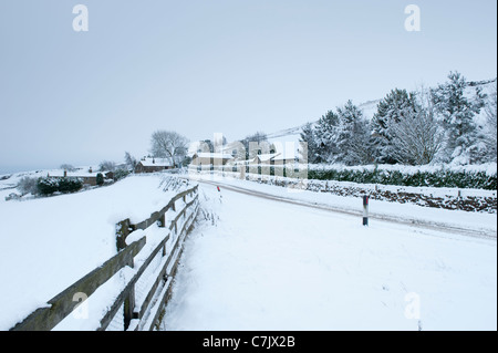 The moor road to Ilkley, covered in snow. - Stock Photo
