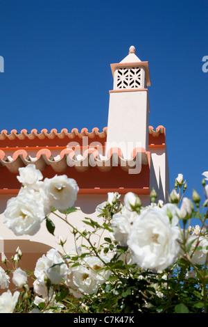 Portugal, Algarve, Near Silves, Chimney & White Roses - Stock Photo