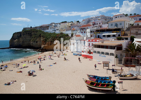 Portugal, Algarve, Carvoeiro, View of Town & Boats on The Beach - Stock Photo