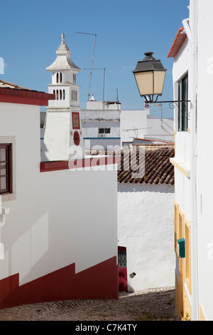 Portugal, Algarve, Alte, Backstreet Chimney & Lantern - Stock Photo