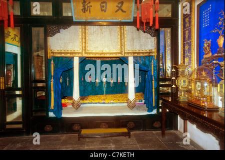 Forbidden City Peking Beijing China royal palace inside furniture look inside room palace museum ancient wood bedroom - Stock Photo
