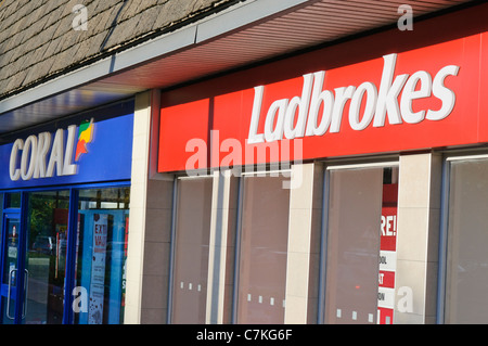 Coral and Ladbrokes betting shops beside each other - Stock Photo