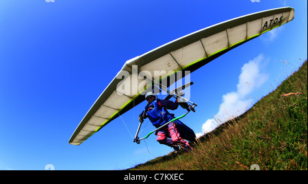 Man taking off on hang glider - Stock Photo