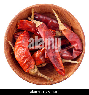 Dry red chili pepper in a wooden bowl isolated on white background - Stock Photo