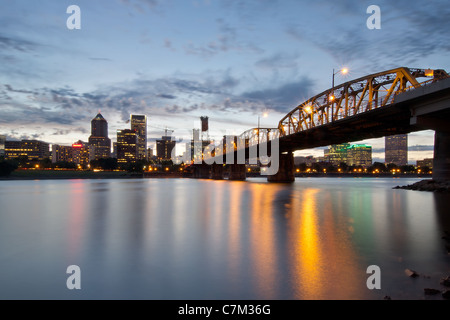 Portland Oregon Skyline and Hawthorne Bridge Over Willamette River at Sunset - Stock Photo