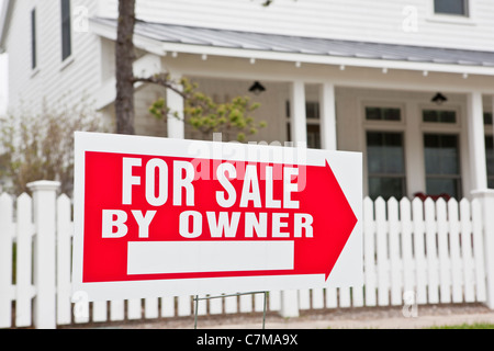 For Sale sign at a Green Technology Home - Stock Photo