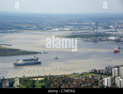 Looking up the River Thames from Tilbury, with the Dartford Crosiing visible, South East England - Stock Photo