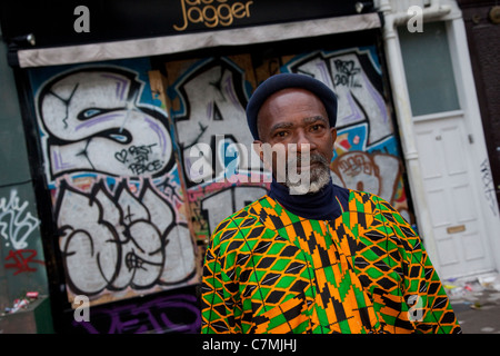 Black man in colourful clothing at Notting Hill Carnival, London - Stock Photo