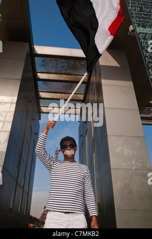 Paris, France, Arab Demonstration in Support of the Yemen Revolution at the Peace Mon-ument. Man Waving Yemeni Flag - Stock Photo