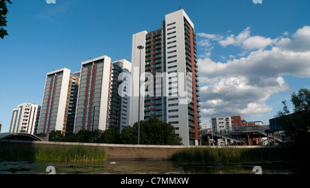 New high rise housing apartment buildings tower blocks (towers) at Virginia Quay flats against skyline near DLR - Stock Photo