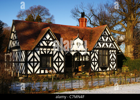 A half timbered Tudor style gatekeepers lodge on the Chirk Castle estate in North Wales - Stock Photo