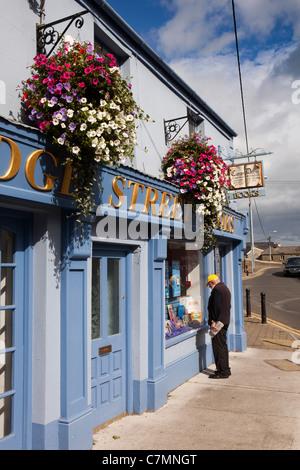 Ireland, Co Wicklow, Wicklow town centre, Bridge Street Book Shop, man looking at window display - Stock Photo
