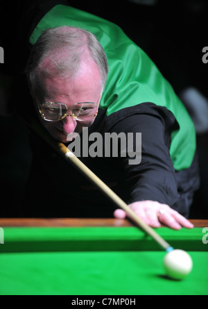 UK, Dennis Taylor, former World Snooker Champion and BBC commentator playing a set of exhibition games - Stock Photo