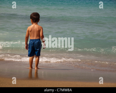 Boy 4 years old on the seashore,Istron Beach near Istro,Eastern Crete,Greece - Stock Photo