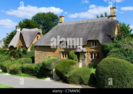 Thatched cottages in the Cotswold village of Great Tew, Oxfordshire, England, UK - Stock Photo