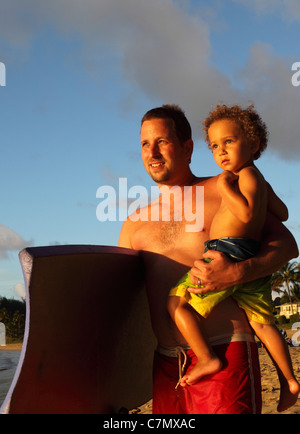 Father and son at Hanalei Beach on Kauai - Stock Photo